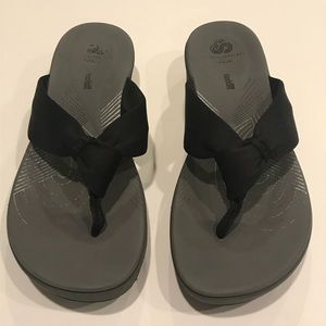 0fd53fa2252e Clarks Shoes - Clarks Arla Glison Flip Flop Wedge Sandal In Black